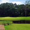 A view over the water of green at Pine Lakes Country Club