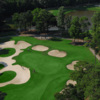 Aerial view of green protected by bunkers at Arcadian Shores Golf Club