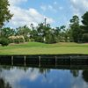 A view over the water of a green at Legend Oaks Golf Club
