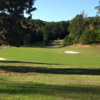 A sunny day view of a fairway at Foxwood Hills Country Club.